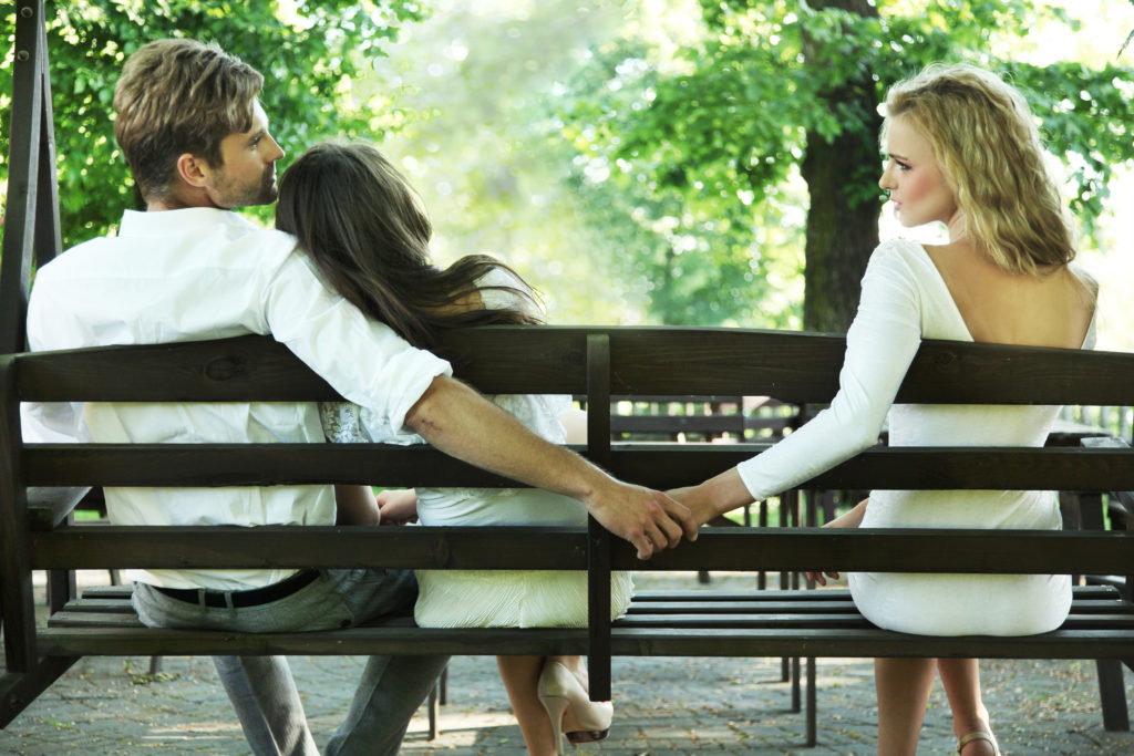 Man cheating on his wife on a park bench